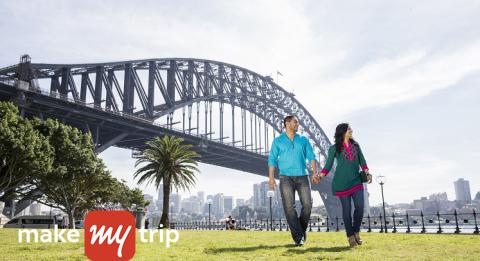 A couple enjoying holidays on Sydney Harbour in Sydney
