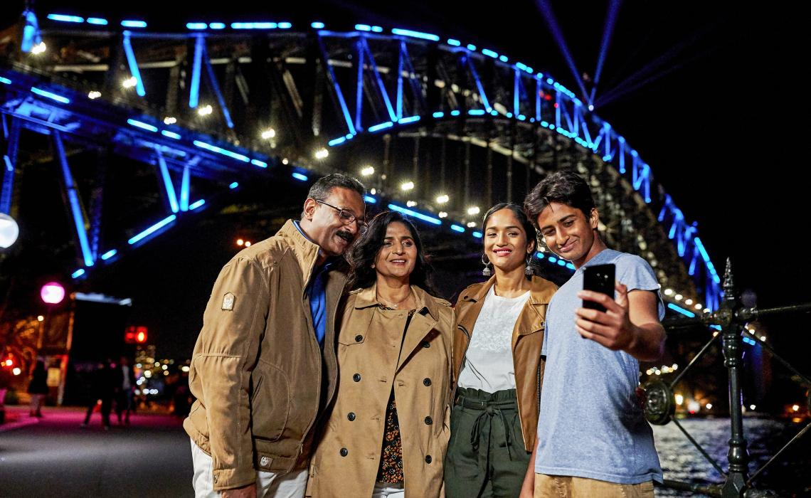 Family enjoying a night out in The Rocks during Vivid Sydney 2018